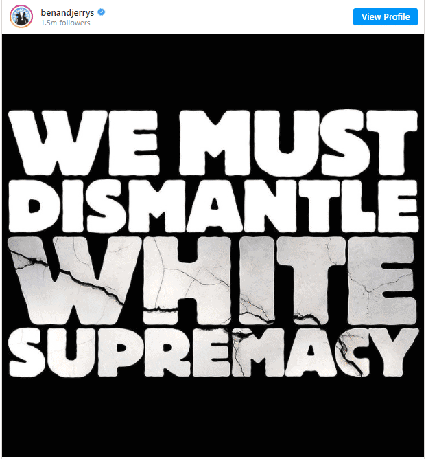 White Text On Black Background reads We Must Dismantle White Supremacy